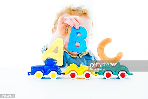 2 Year Old Boy Playing With Colorful Letters