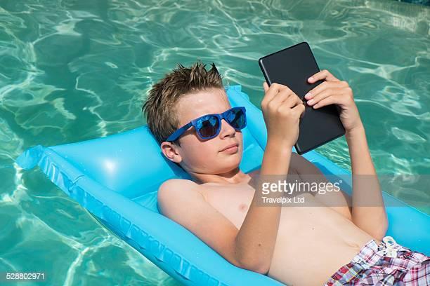 12 year old boy reading digital book