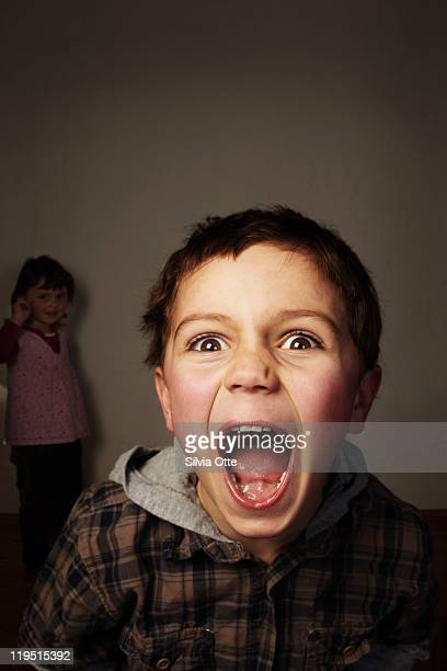 5 year old boy screaming at camera