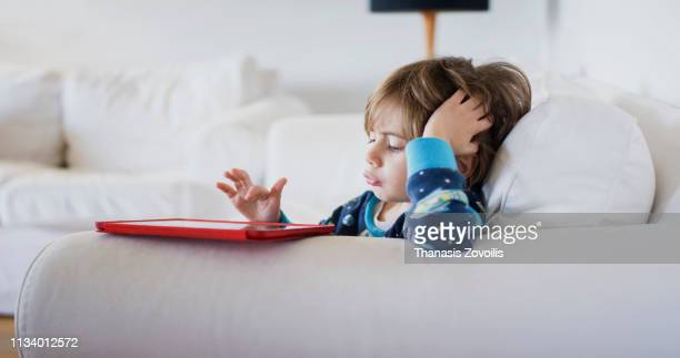 4 year old boy using a digital tablet