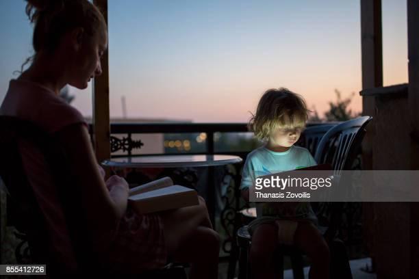 2 year old boy using a digital tablet