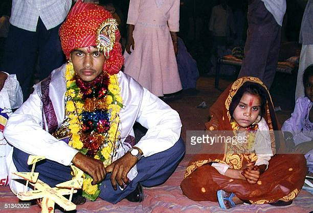 A 16 year old boy waits to be married to a much younger girl during a mass child marriage ceremony in Indore 15 May 2002 some 200 kms west of the...