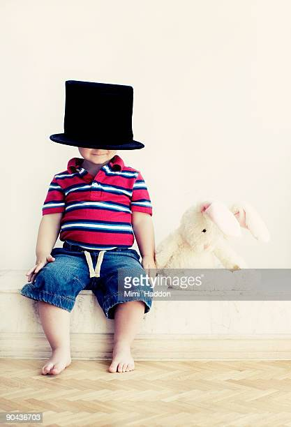2 Year Old Boy Wearing Top Hat with Toy Rabbit