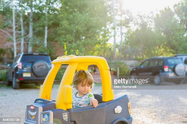 3 year old boy with his toy car