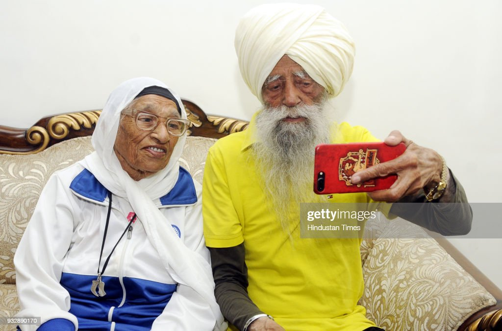 107 year old British Sikh marathon runner Fauja Singh takes selfie with 102 years old Marathoner Mann Kaur and before the short marathon Physical...