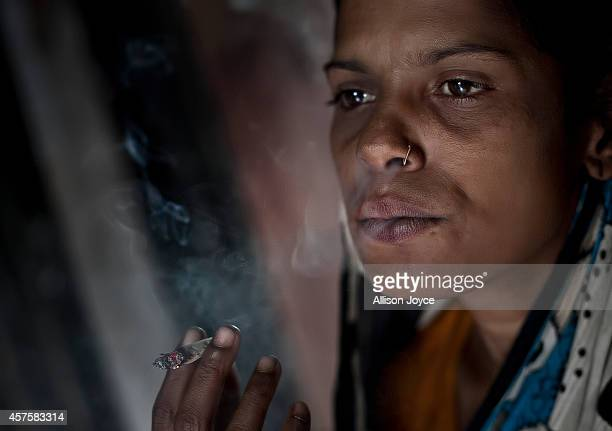 25 year old Bulboli smokes October 18 2014 in Tangail Bangladesh There are no tears left now she says Since the eviction I'm all alone I don't go...