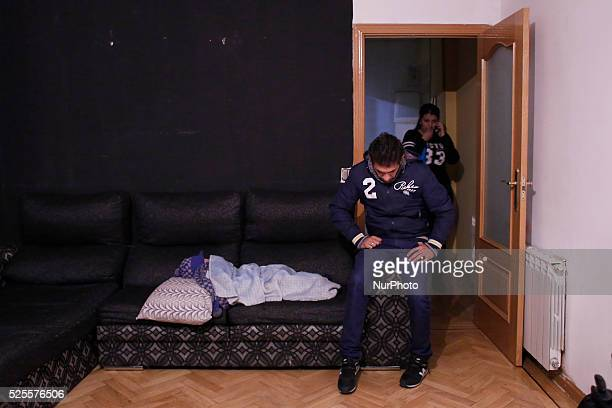 23 year old Carolina Salazar Fernandez accommpanied by his friend Juan Antonio speaks through the telephone while her 3 yearold son Jesus sleeps on...