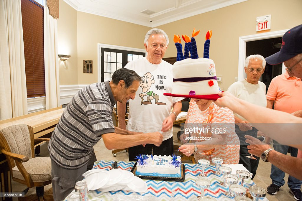 80 Year Old Caucasian Man Celebrates His Birthday With Friends Stock Photo