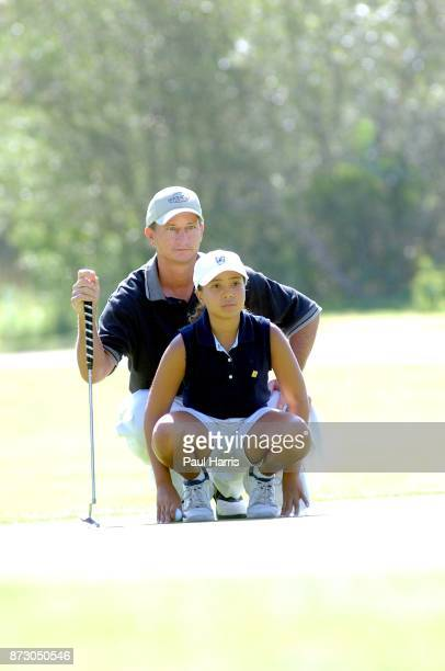 10 year old Cheyenne Woods niece of Golfer Tiger Woods with her coach Kent Chase takes part in a junior golf tournament at The Singing Hills Resort...