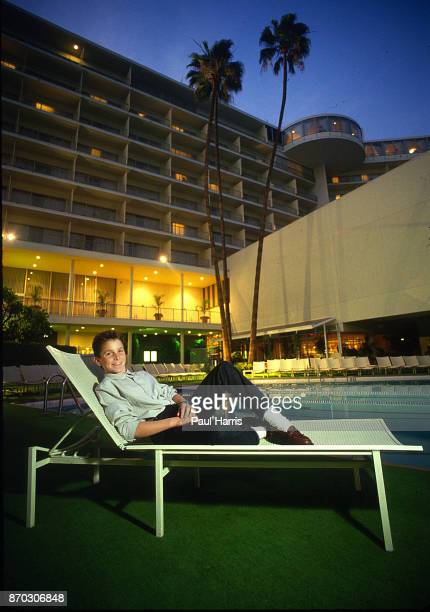 Year old Christian Bale at the Beverly Hilton Hotel during a publicity tour for Empire Of The Sun. He sits on a deck chair beside the swimming pool...