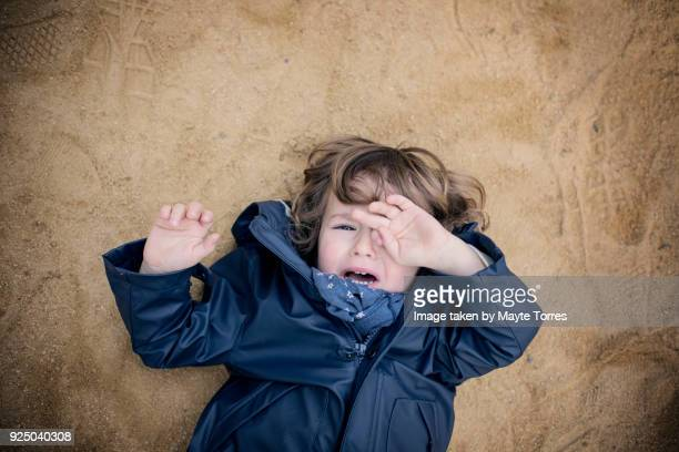 3 year old crying laying on the floor - autism spectrum disorder stock photos and pictures