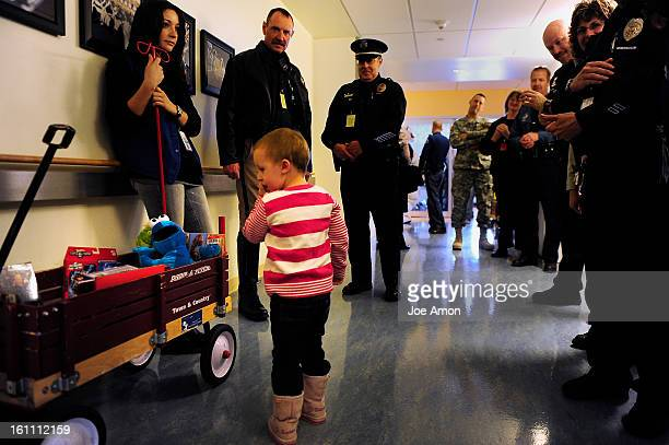 3 year old Danika Huston of Mitchell NB looks over the preasents brought by more than 150 uniformed law enforcement officers from throughout the...
