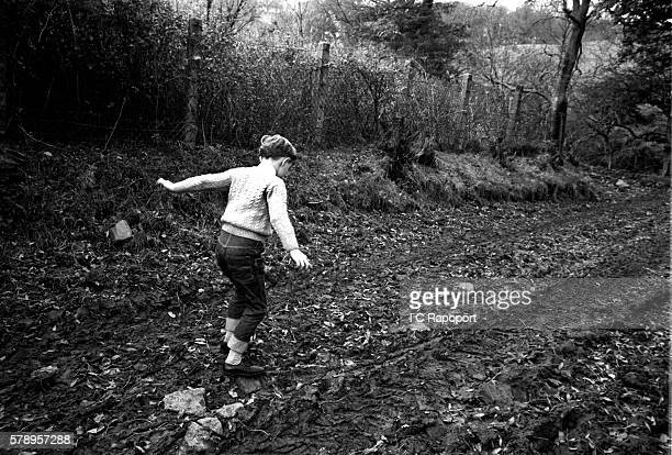 9 year old David Davies one of the few survivors of his classroom roams his family farm close to the site of his school that was destroyed by a...