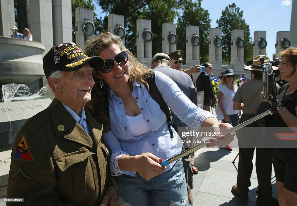 96 year old D-Day veteran George Krakosky of Gettysburg, Pa.has his picture taken during a D-Day anniversary wreath laying ceremony at the National World War II Memorial on June 6, 2016 in Washington, DC. It was 72 years ago today when Krakosky landed on Omaha Beach with the US Army 29th Infantry Division.