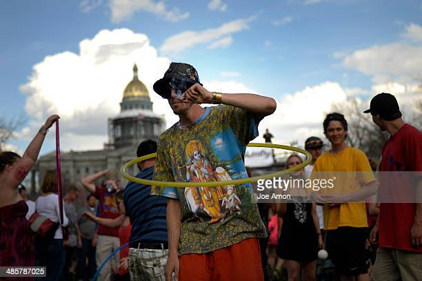 22 year old Don Blosser of Denver smokes a joint as he hula hoops after the smoke out at the 420 celebration at the Denver 420 Rally in Civic Center...