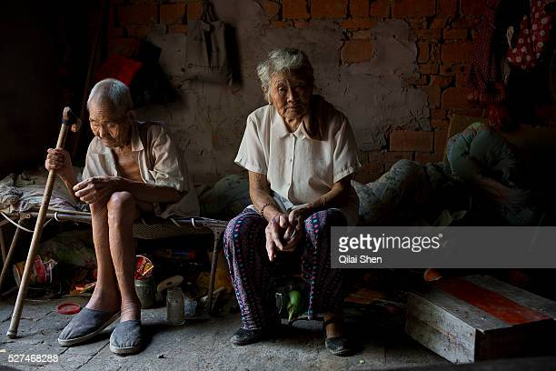 87 year old Dou Shengli and 85 year old He Xiuying sit in their home at a rural village near Fuyang Anhui Province China on 28 August 2013 As...