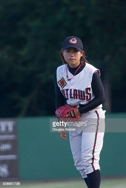 18 year old Eri Yoshida the Knuckle Princess gets ready to pitch a knuckleball during the game where her jersey and the bat she used when she became...