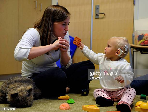 1 year old Eva Riggs works with Lynne Spies a speech pathologist at Children's Hospital Joe Amon The Denver Post