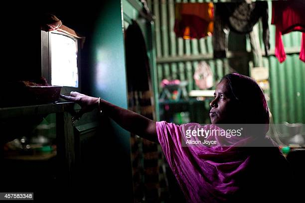 35 year old former Kandapara brothel sex worker Maya changes the channel on her TV on October 17 2014 in Tangail Bangladesh When she was very young...