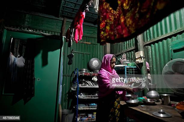 35 year old former Kandapara brothel sex worker Maya cooks dinner October 17 2014 in Tangail Bangladesh When she was very young her parents got...