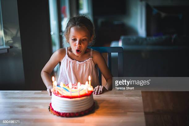 7 Year Old Girl Blowing Out Birthday Candles