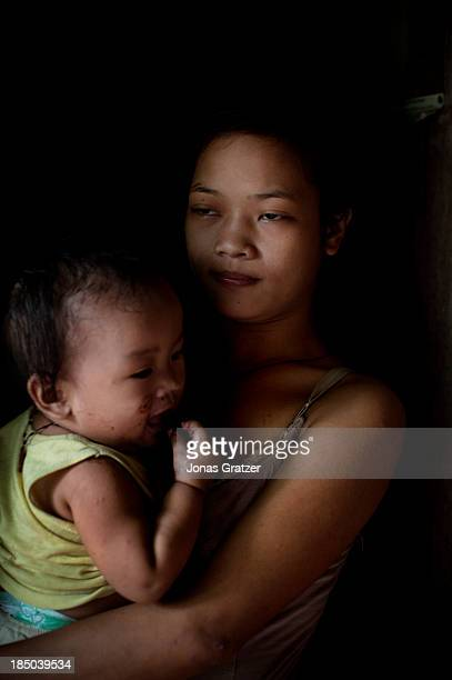 A 14 year old girl carries her 10 month old baby she is forced to make a living through prositution in Cagayan de Oro Abortion in the Philippines is...