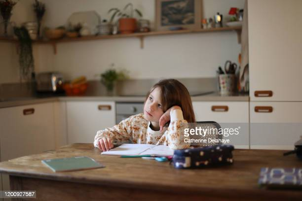 a 6 year old girl doing her homeworks in the kitchen - one girl only stock pictures, royalty-free photos & images