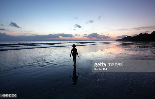 A 9 year old girl enjoying Sunset,Radhanagar Beach