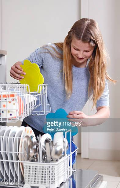12 year old girl filling up dishwasher