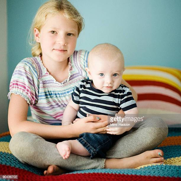 8 Year Old Girl Holding 3 Month Old Baby Boy