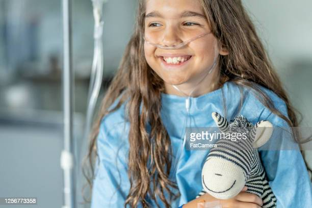 10 year old girl in hospital - medical oxygen equipment stock pictures, royalty-free photos & images