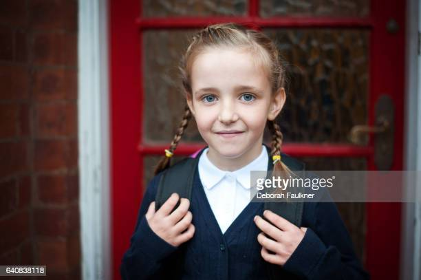 7 year old girl in school uniform - schuluniform stock-fotos und bilder