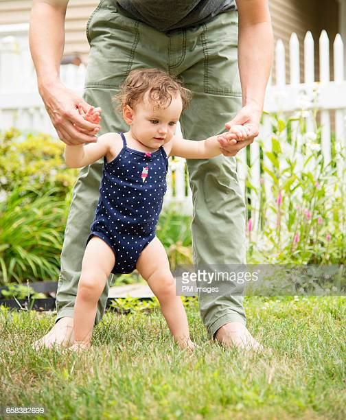 1 year old girl learning to walk