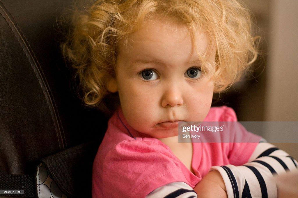 2 year old girl looking grumpy : Stock Photo