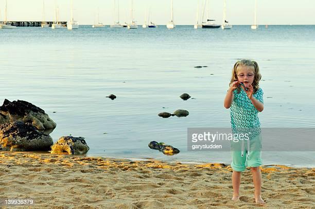 6 year old girl on a beach.