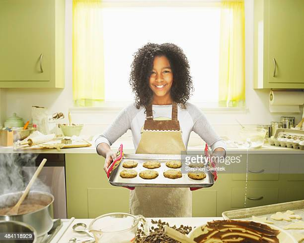 9 year old girl posing with baked cookies