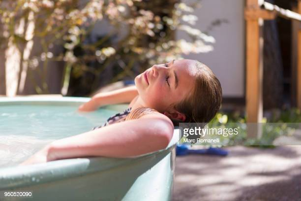 12 year old girl relaxing in a hot tub