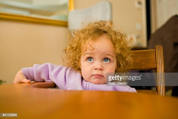 1-2 year old girl sitting at student desk
