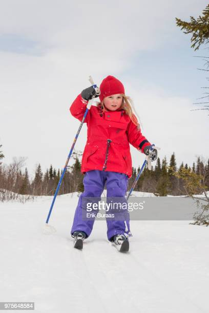 A 4 year old girl skiing