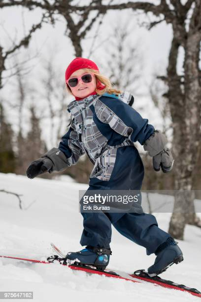 4 year old girl skiing without poles