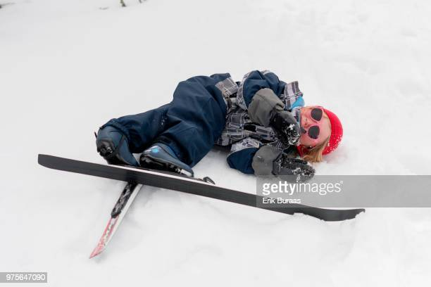 4 year old girl with skis on the ground
