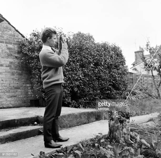 23 year old Gordon Faulkner in his garden holding the camera with which he photographed 'The Thing' UFO flying over Warminster 9th September 1965