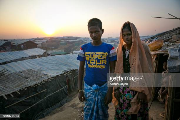 COX'S BAZAR BANGLADESH NOVEMBER 27 18 year old Hashimullah poses for a photo with his new bride 16 year old Farmina Begum on the day of their wedding...