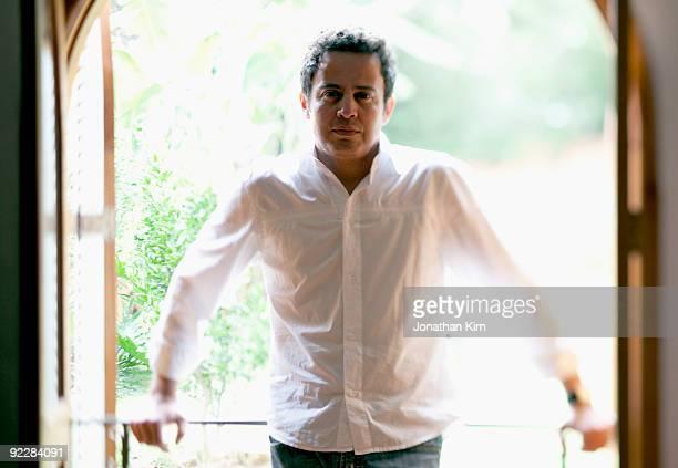 44 year old Hispanic man in window.