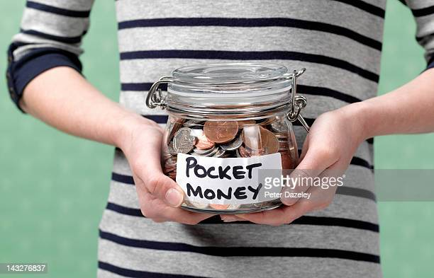 10 year old holding jar full of pocket money - childhood stock pictures, royalty-free photos & images