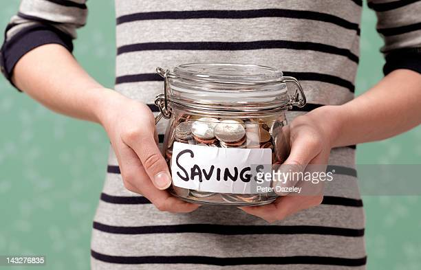 10 year old holding savings in jar - saving stock pictures, royalty-free photos & images