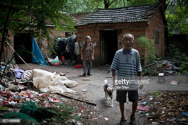 71 year old Hou Guiying and her husband 81 year old Ma Jinling walk out of their home at a rural village near Fuyang Anhui Province China on 28...