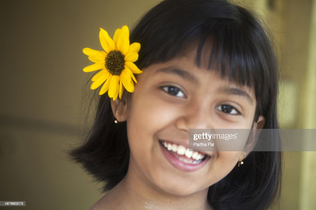 A 10 Year Old Indian Girl With Sunflower Stock Photo | Getty Images