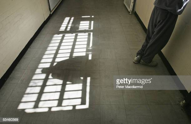 19 year old inmate James looks out of the window of the Young Offenders Institution attached on August 25 2005 in Norwich England A Chief Inspector...