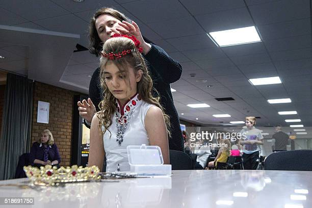 A 12 year old Irish dancer from Hong Kong has her hair done by her mother before taking to the stage in the heats for the under 13's World Irish...